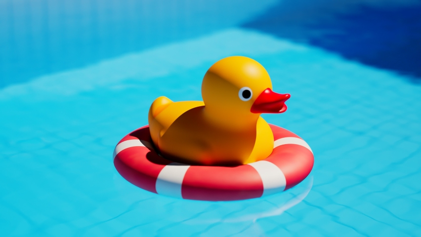 Rubber duck on life ring floating in the beautiful swimming pool. Camera panning around the cute yellow toy in the cristal clear water. Joyful and cheerful atmosphere. Time for play. Summer. Sunny day