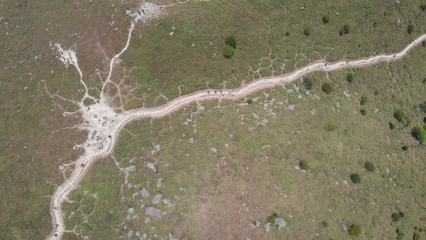 Aerial view down the mountain trails. Hiking destination in Hong Kong. Drone shot.    Shutterstock HD Video #1061417419