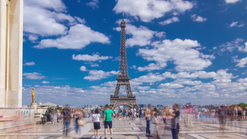 Famous square Trocadero with Eiffel tower in the background timelapse hyperlapse. Trocadero and Eiffel tower are the most visited attractions of Paris. Blue cloudy sky at summer day | Shutterstock HD Video #1061417929