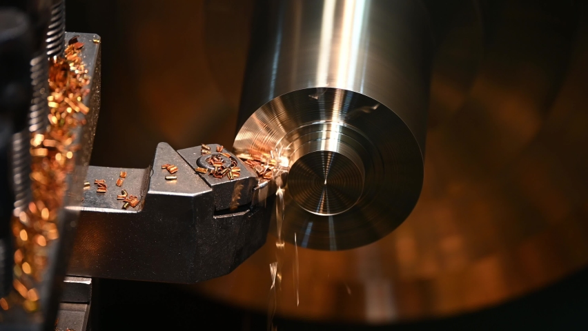 Close-up 4K scene operation of lathe machine cutting the brass shaft parts and the cutting chips. The metalworking process by turning machine.   Shutterstock HD Video #1061428381