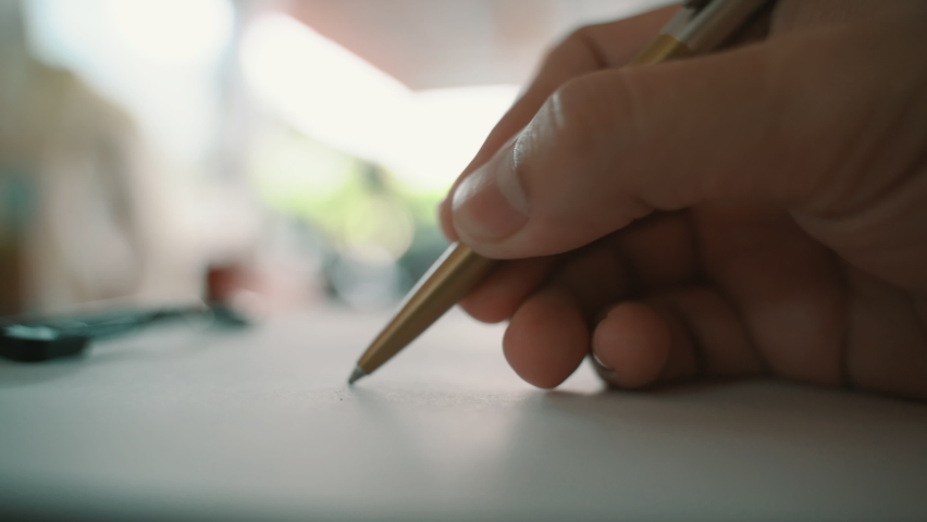 A male hands writing on a piece of paper. Writing essay or love letters. Royalty-Free Stock Footage #1061430868