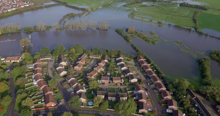 Overhead footage of flooded fields next to residential property in England, UK