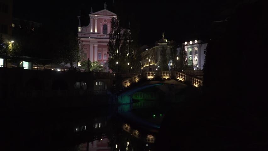 Triple bridge and Ljubljanica in and old town Ljubljana at night | Shutterstock HD Video #1061440285