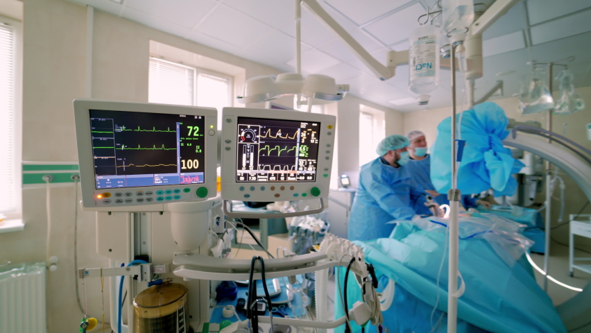 Health monitors in intensive care unit. Screen of monitors showing vital signs of a patient during the operation in hospital. Health care concept. Royalty-Free Stock Footage #1061449810