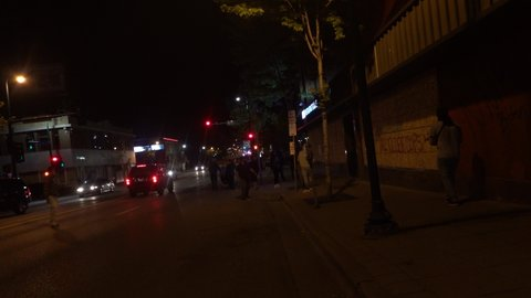 Minneapolis, Minnesota - 5/29/2020 - Heated standoff between group of young men and an armed guard inside of a Chinese Restaurant during riots.
