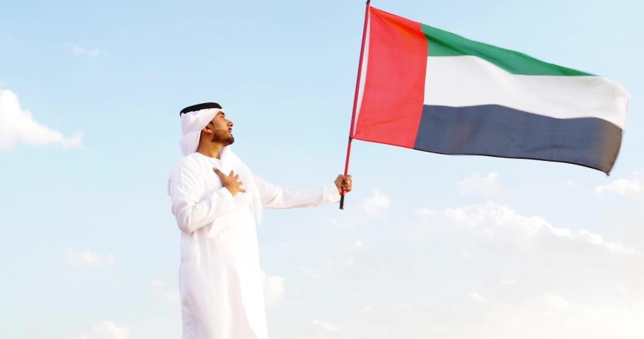 Business men wearing traditional uae white kandura spending time in the desert of Dubai | Shutterstock HD Video #1061461918