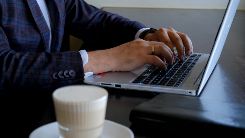 Typing on a laptop keyboard in close-up. Hands typing on computer keys. Working remotely. Freelance programmer Royalty-Free Stock Footage #1061463184