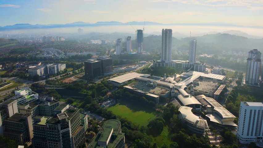 Aerial Drone 4K UHD anamorphic with Desqueeze factor of 1.15x 1.33x view of Putrajaya city and administration office building during morning sunrise. | Shutterstock HD Video #1061475526
