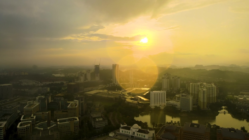 Aerial Drone 4K UHD anamorphic with Desqueeze factor of 1.15x 1.33x view of Putrajaya city and administration office building during morning sunrise. | Shutterstock HD Video #1061475529