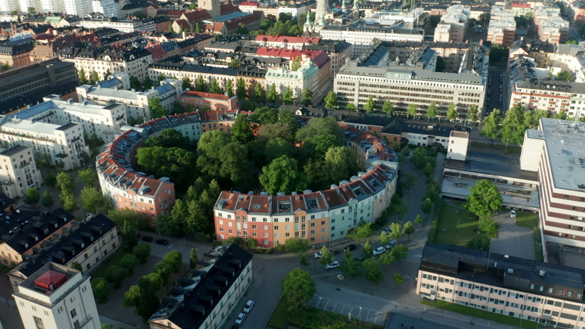 Aerial view of circle shaped residential buildings | Shutterstock HD Video #1061476435