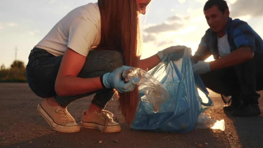 teamwork trash volunteer concept. people group clean on collects garbage plastic trash paper teamwork waste bottles trash. environmental team clean a ecology volunteer awareness pollution Royalty-Free Stock Footage #1061479789