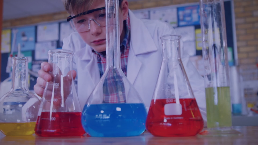 Animation of symbols, numbers and scientific data processing over schoolboy holding beaker and experimenting in laboratory. Global science learning education concept digitally generated image. | Shutterstock HD Video #1061480131