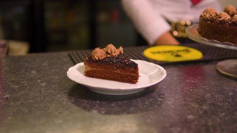 amazing push in shot of a freshly served chocolate cake in restaurant in slow motion