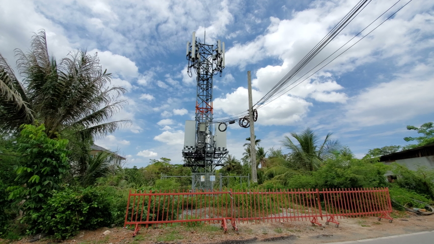 5G and 4G LTE cell tower in rural countryside of generic developing country Royalty-Free Stock Footage #1061490397