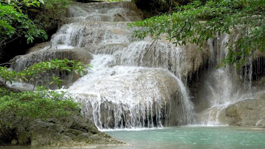 Erawan waterfall first level in National Park, famous tourist destination in Kanchanaburi, Thailand.