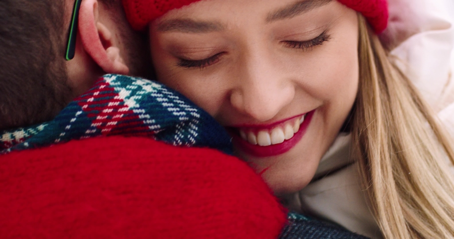 Close up of face of young happy woman running towards her boyfriend and hugging him. Romantic winter story. Royalty-Free Stock Footage #1061503804
