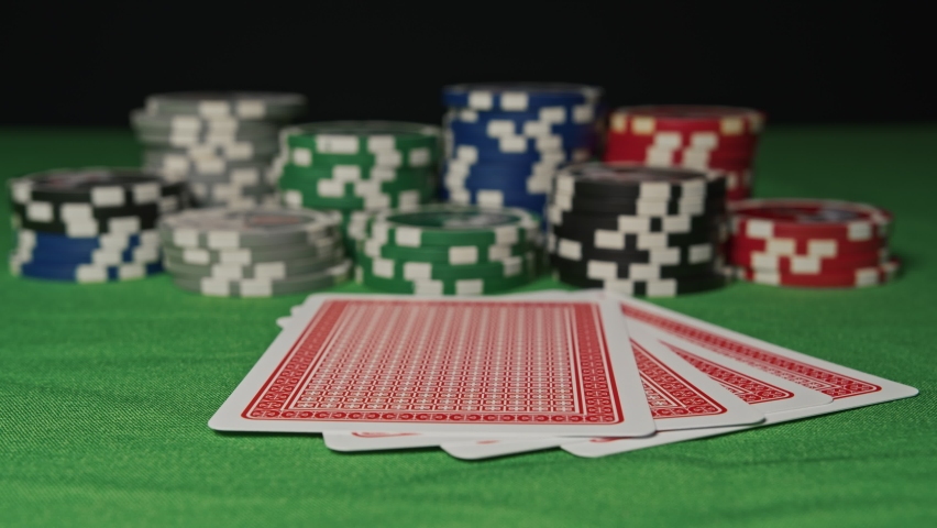 Four aces in his hands on the table | Shutterstock HD Video #1061504929