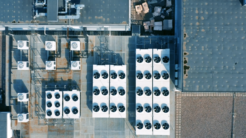 Heating, ventilation and air conditioning systems installed on the rooftop. Aerial top down view Royalty-Free Stock Footage #1061505934