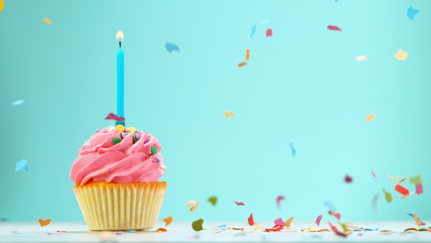 Birthday Cake With Burning Colorful Candle on Pastel Blue Background. Super Slow Motion, 1000 FPS. Royalty-Free Stock Footage #1061513593