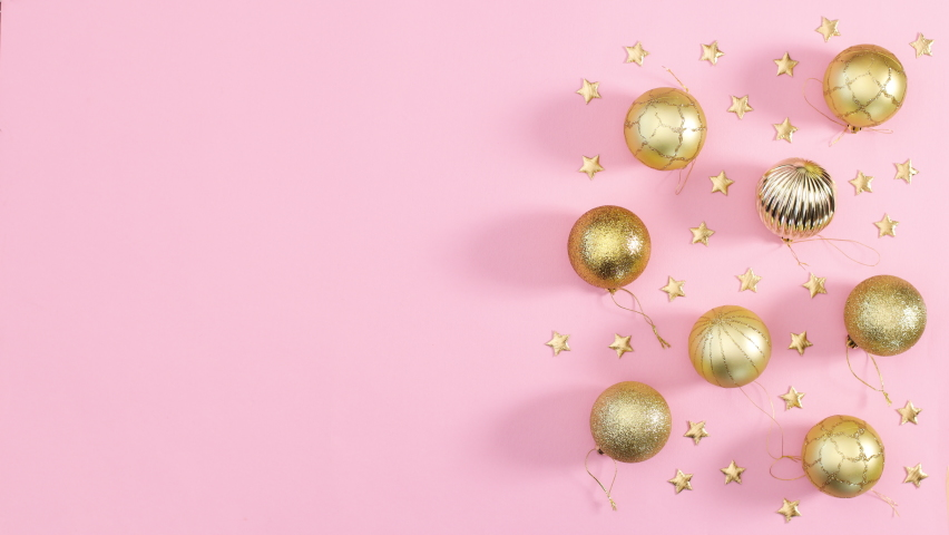6k Frame for text appear on pink theme with gold Christmas ornaments. Stop motion  | Shutterstock HD Video #1061521042