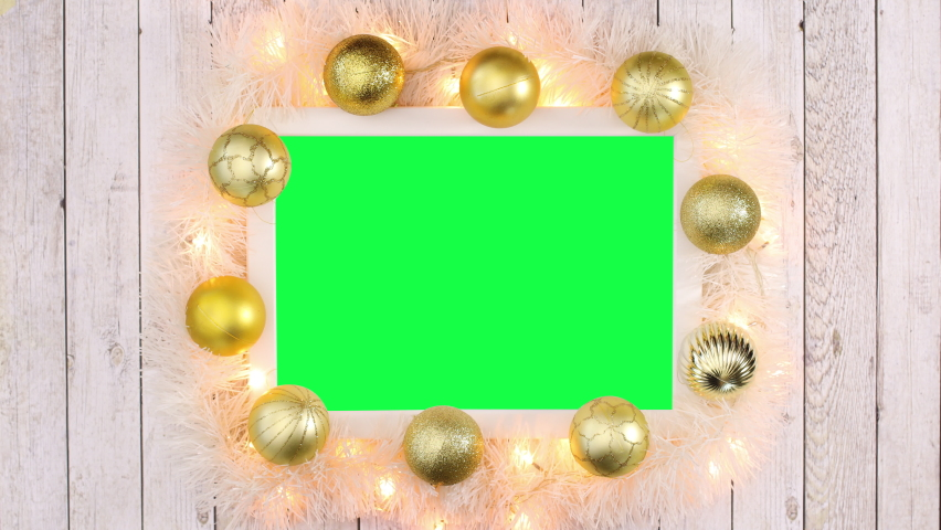 6k Gold Christmas frame with gold balls, blinking lights and green screen. Stop motion | Shutterstock HD Video #1061521048