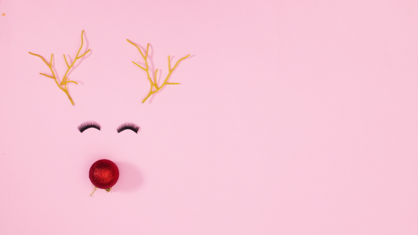 6k Christmas reindeer blinking with eyelashes on pastel pink theme. Stop motion | Shutterstock HD Video #1061521051
