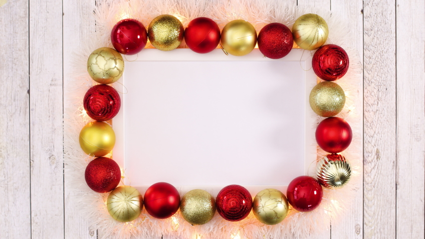6k Empty white frame for text and Christmas ornaments and blinking lights around. Stop motion   | Shutterstock HD Video #1061521060