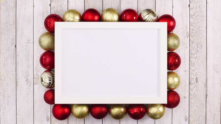 6k Gold and red Christmas ornaments appear around empty frame for text. Stop motion  | Shutterstock HD Video #1061521066