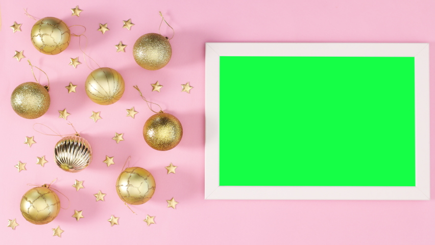 6k White frame with green screen and gold Christmas decoration on pastel pink theme. Stop motion | Shutterstock HD Video #1061521069