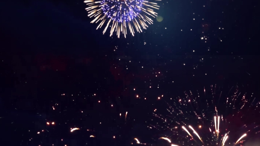 4K Beautiful Multi colored Fireworks in Night sky. New year's Fireworks Show Explosions Celebration. Bokeh Lights. Happy Birthday, Wedding, Anniversary, Confetti, Diwali, Christmas, Holiday, Event. | Shutterstock HD Video #1061521420