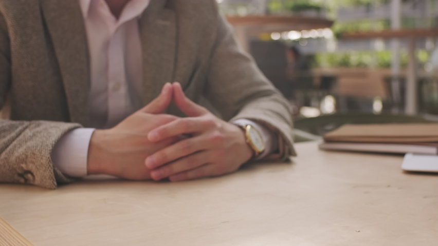 Close up mid-section shot of unrecognizable businesswoman and businessman shaking hands after making deal in cafe | Shutterstock HD Video #1061526271