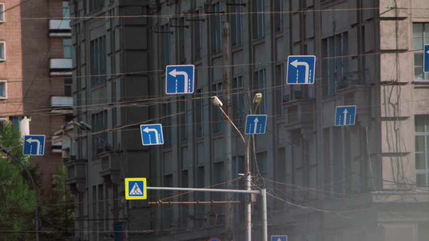 Road signs on the background of the building. Traffic signs. | Shutterstock HD Video #1061528998