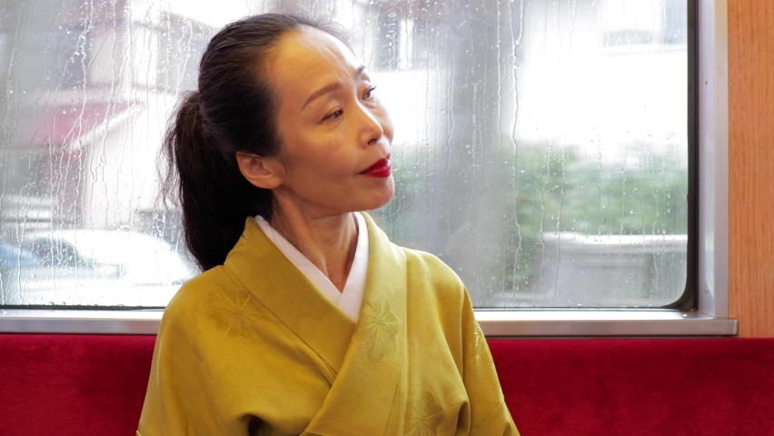 Elegant Japanese woman riding a train in Kyoto | Shutterstock HD Video #1061529244