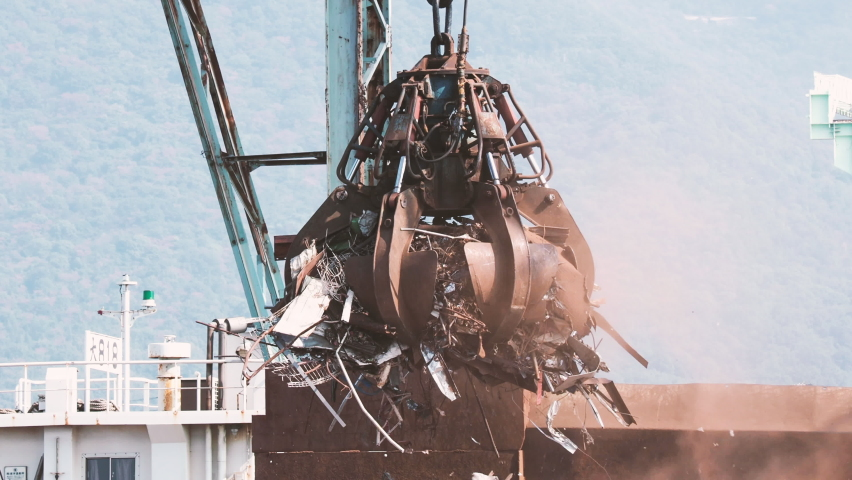 A Huge Crane Grabbing Many Industrial Wastes near The Sea, Nobody, Industrial Image | Shutterstock HD Video #1061535112