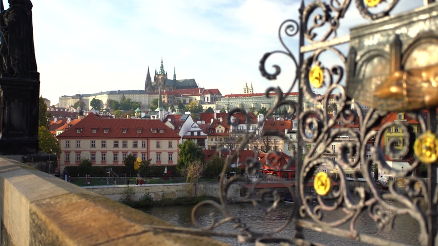 gilded railings on Charles Bridge and in the background Prague Castle and the Church of St. Vitus in the center of Prague | Shutterstock HD Video #1061535457