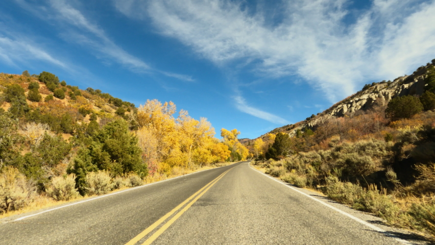 Autumn fall drive mountain scenic byway colorful POV fast 4K. Beautiful autumn fall colors along Wasatch Mountains. Valley landscape with road and colorful fall trees. Rural farming community road. | Shutterstock HD Video #1061538088