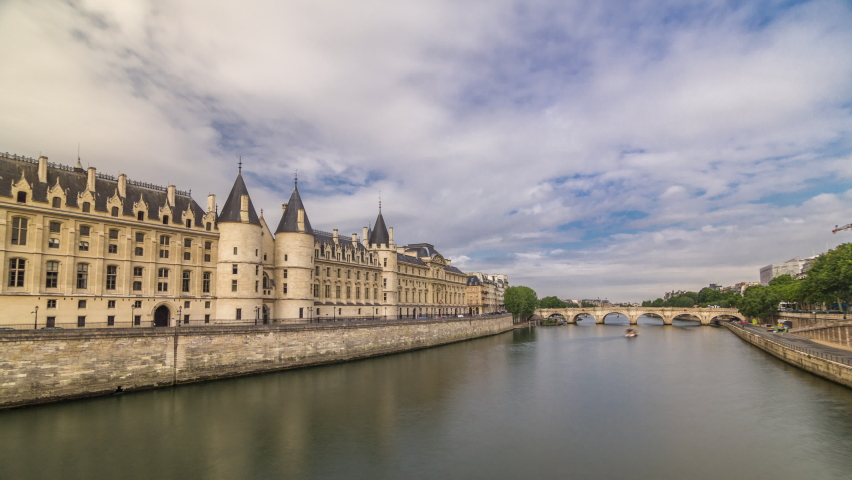 Castle Conciergerie timelapse hyperlapse - former royal palace and prison. View from Bridge to Change. Conciergerie located on the west of the Cite Island and today it is part of larger complex known