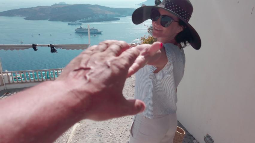 Beautivul woman with hat enjoy summer vacation walking on streets of Santorini   Shutterstock HD Video #1061549776