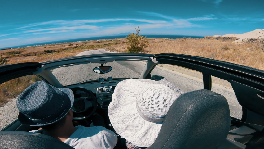Lifestyle of couple driving on road trip in convertible, Santorini Island, Greece | Shutterstock HD Video #1061549779