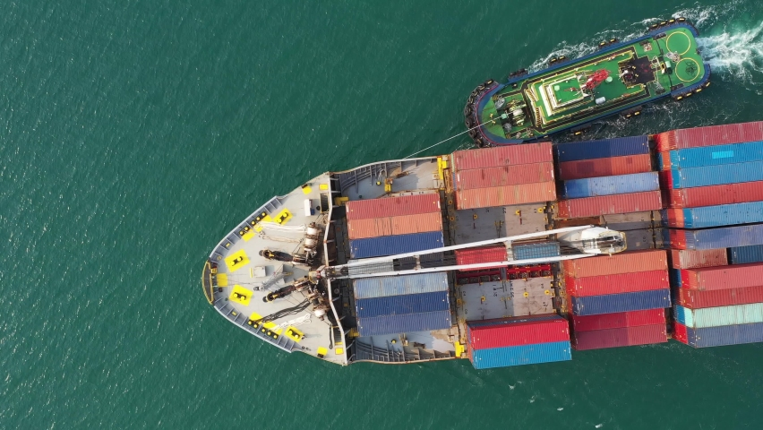 Aerial view of International Containers Cargos ship,Freight Transportation, Shipping,Trade Port,Shipping cargo to harbor, Nautical Vessel.Logistics import export Container Cargo ship over sea business | Shutterstock HD Video #1061550247