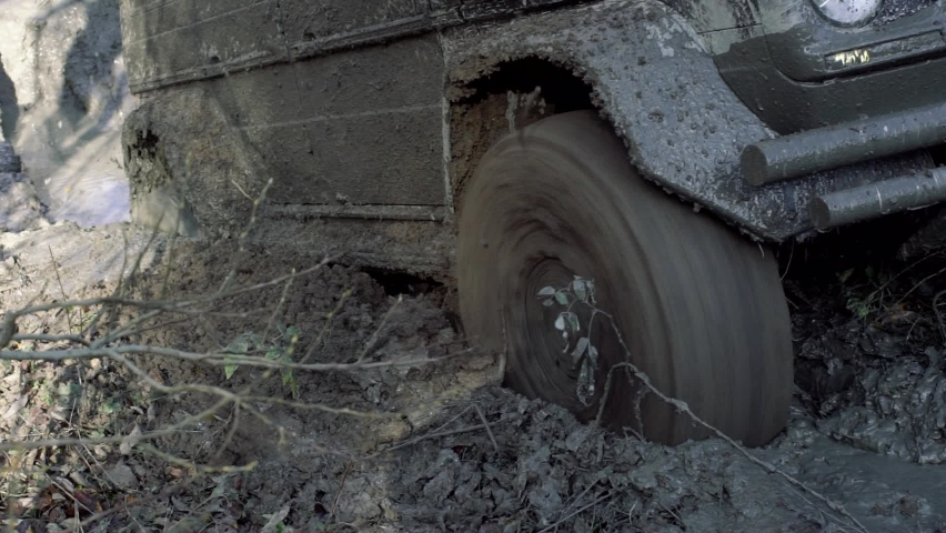 Tire mud. Offroad car on bad road, slow motion | Shutterstock HD Video #1061569360