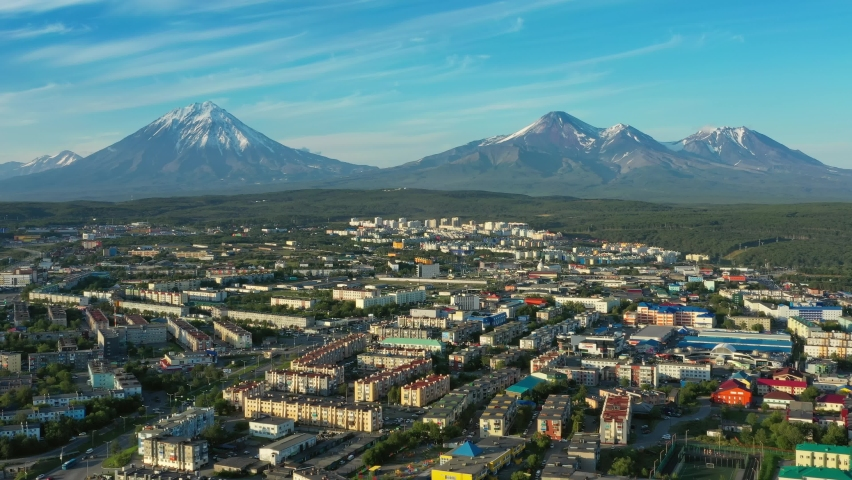 Flying over Petropavlovsk-Kamchatsky city at sunset and cone of volcano. Kamchatka Peninsula, Russia, 4k | Shutterstock HD Video #1061581102