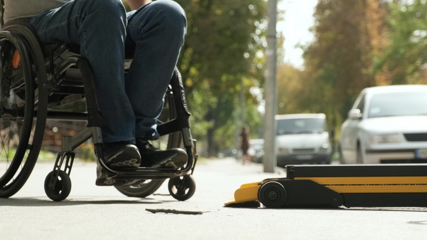 A man in a wheelchair on a lift of a vehicle for people with disabilities. Lifting equipment for people with disabilities - man in wheelchair near the vehicle Royalty-Free Stock Footage #1061582617