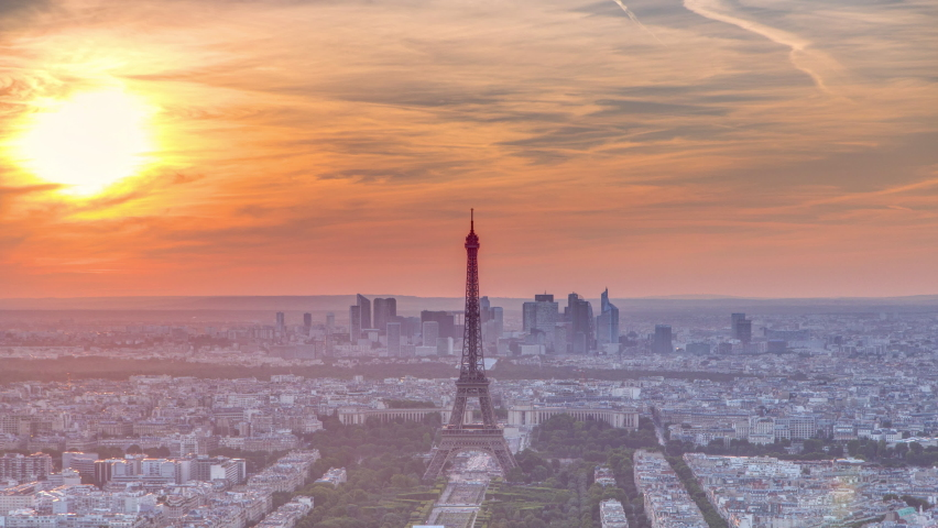 Panorama of Paris at sunset timelapse. Eiffel tower view from observation deck of montparnasse building in Paris - France. Colorful sky at summer day | Shutterstock HD Video #1061583187