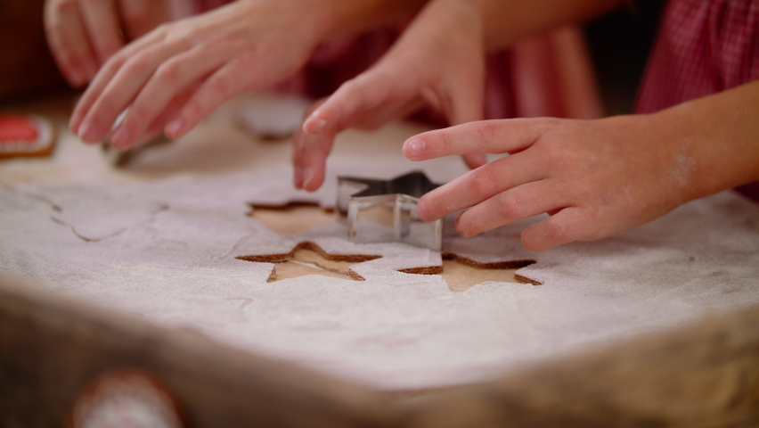 Close Up Of The Caucasian Hands Of Children Daughter Making A Gingerbread Cookie In The Form Of A Star And Christmas Tree. Family Spending Time Together At Home. Christmas And New Year Concept Slow Mo Royalty-Free Stock Footage #1061593723