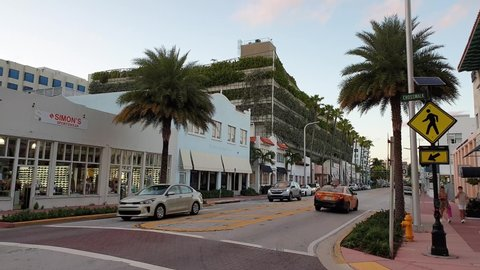 Landscape view of street of Miami. Colorful buildings on blue sky with white clouds background.  USA. Miami South Beach. 09.24.2019.