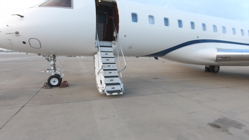 Entering a luxury private jet using the airplane stairs Royalty-Free Stock Footage #1061606467