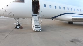 Entering a luxury private jet using the airplane stairs