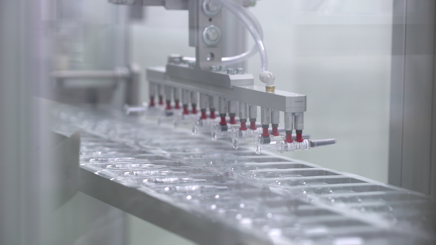 Pharmaceutical manufacturing line automatic machine. Covid-19 coronavirus vaccine Production equipment at pharmacy medical industry. vials ampules vaccines vaccine viruses medicine healthcare medicine