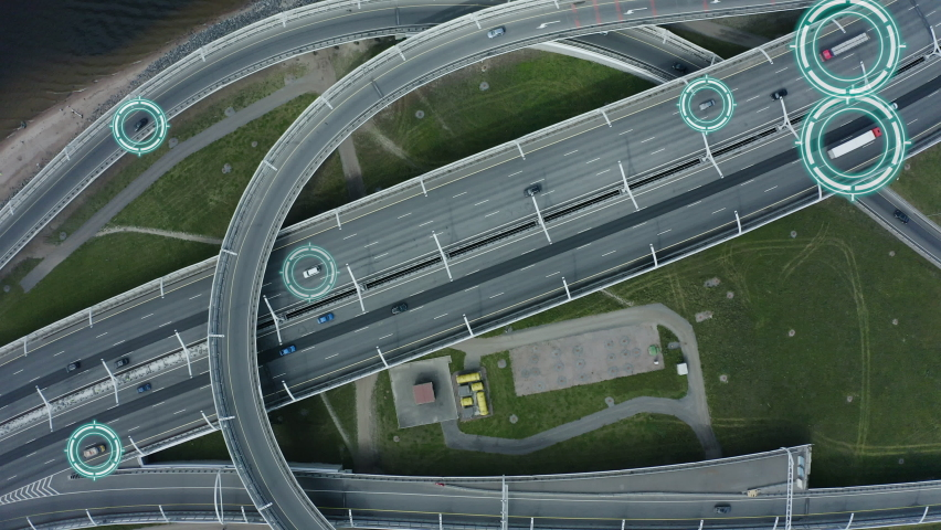 Top down aerial drone view of autonomous self driving cars moving through city Spbd. traffic on junction. Artificial intelligence in automotive industry. contol concept Royalty-Free Stock Footage #1061628394